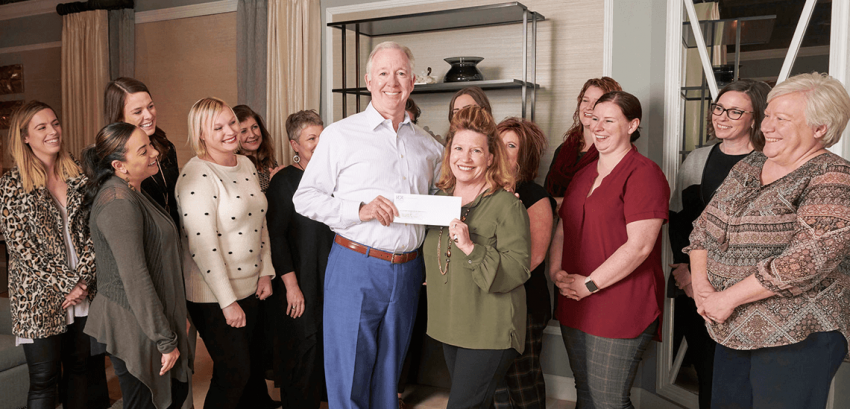 KDR Showrooms Supports Carl's Cause Photo of KDR Staff giving Donation 2019